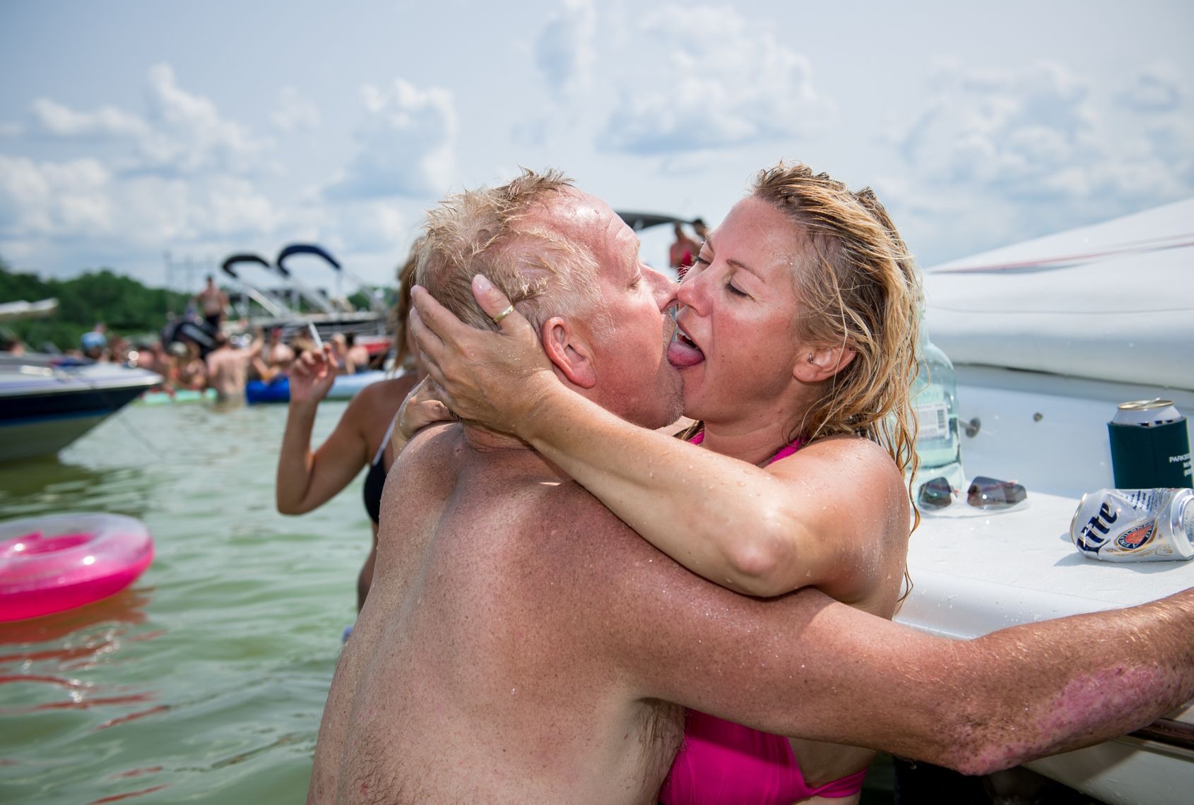Sun burned couple making out, quirky, sex, kissing, couple, real people, lake party, summer, beverage, swimming, swim, suit, bathing, confident, summer fun, liquor, travel, Madison, Chicago, Nashville advertising, beverage, lifestyle