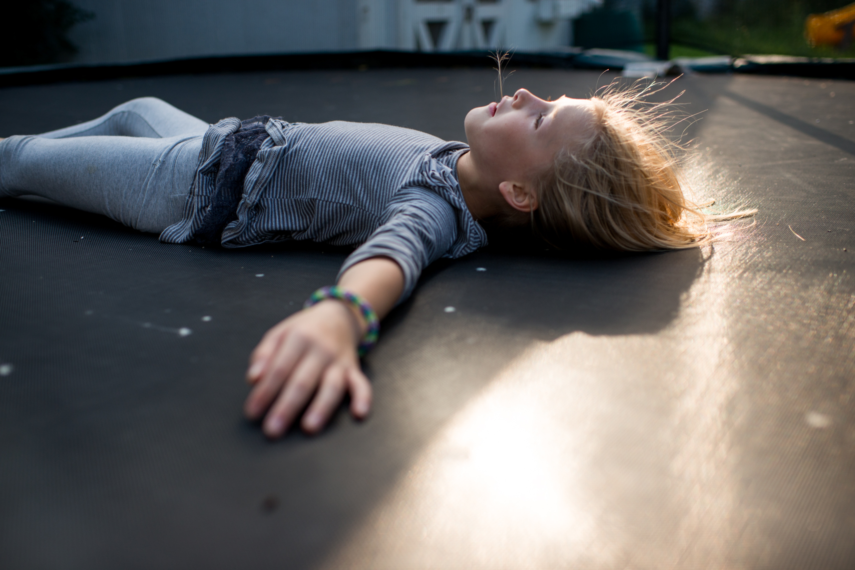 Girl on a trampoline at sunset. Documentary, Editorial, Photojournalist, New Orleans, Nashville, Atlanta, Texas, Austin, Chicago, Washington, D.C., DC, Photographer