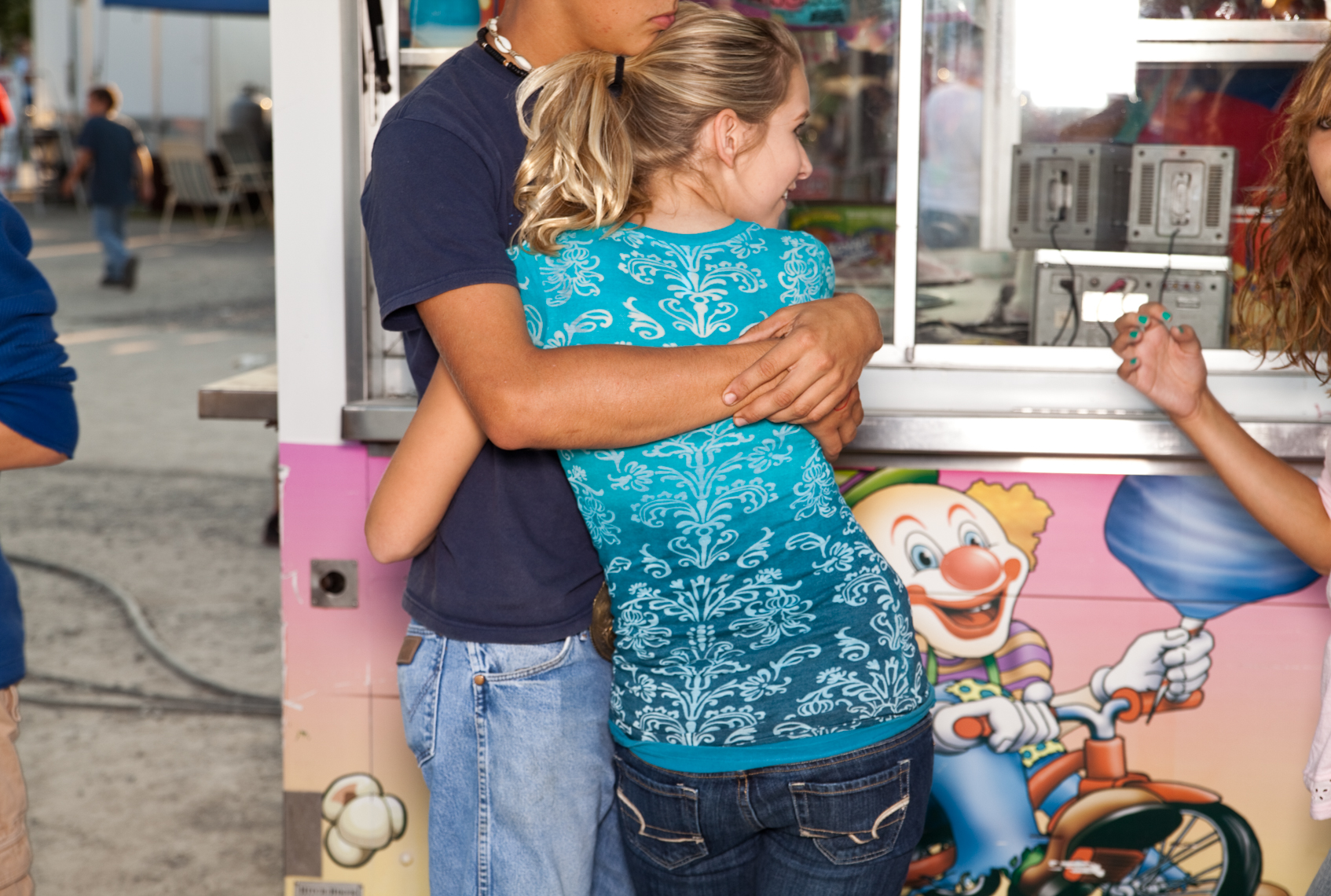 Young teen couple,  Wilson County Fair, Lebanon, Tennessee, carnival, amusement park, rural south, cotton candy, food truck